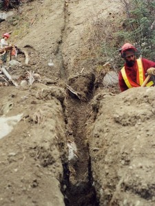 Manually dug trench for central pole drain, breaching berm, Fall 2001