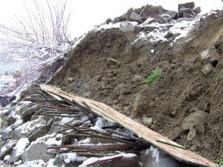 Installation of vegetated riprap on eroded bank
