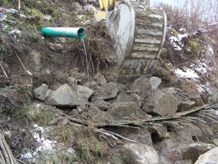 Installation of vegetated riprap on eroded bank below storm water outfall