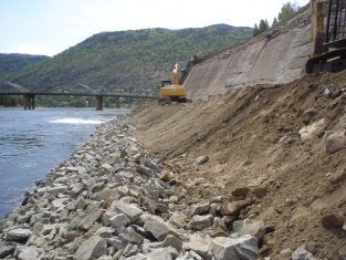First lift of riprap placed, gravel filter placed on bank